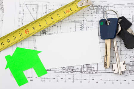 buy house: Model house on construction plan for house building, keys, clipboard and white blank. Real Estate Concept.