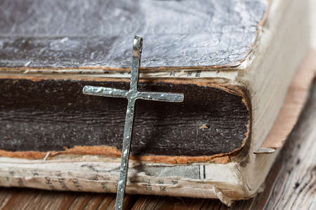old backgrounds: Silver christian cross on bible. Religious concept.