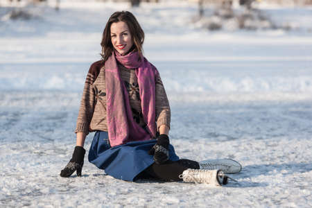 iceskating: Happy girl having fun with iceskating on frozen pond. Winter sport and leisure concept. Stock Photo