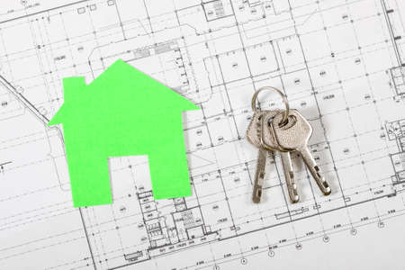 agency agreement: Model house on construction plan for house building with keys . Real Estate Concept. Stock Photo
