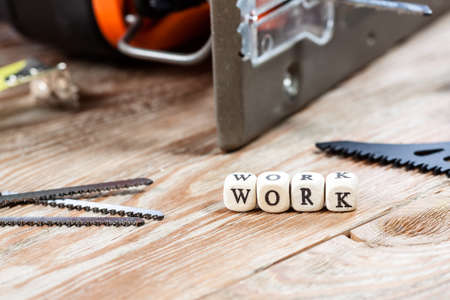 work tools: Word WORK written on a wooden block. Work tools concept. Stock Photo