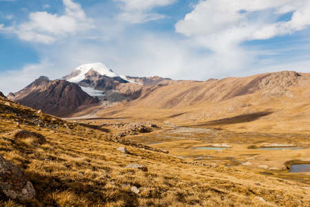 kyrgyzstan: View on mountain peaks, Tien Shan, central asia, Kyrgyzstan. Travel concept bacvkground.