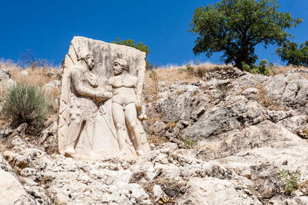 King Mithridates shaking hands with god Herakles, Nemrut National Park, Turkey Stock Photo