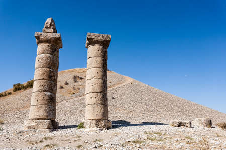 tumulus: View of Karakus Tumulus, ancient historical and blessed area of Nemrut National Park, on clear blue sky background. Stock Photo
