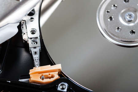 microscopical: Close view of open hard disk drive with spindle. Electronic devices and technology concept. Stock Photo