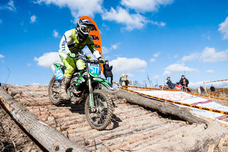 motorcross: Kiev, Ukraine - October 17, 2016: Motocross riders compete with each other on dirt bikes, during Championship of Ukraine on cross-country final stage.