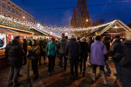 Kiev, Ukraine - December 27, 2015: Crowds of people on Christmas fair on Sophia Square at main Kievs New Year tree.