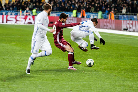 Kyiv, Ukraine - December 6, 2016: Derlis Gonzalez being hit by Olcay Sahan, during match UEFA Champions League game Dynamo Kyiv against Besiktas at NSC Olympic stadium in Kyiv, Ukraine. Editorial