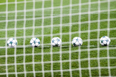 Soccer balls at stadium before the match on green grass. Stock Photo