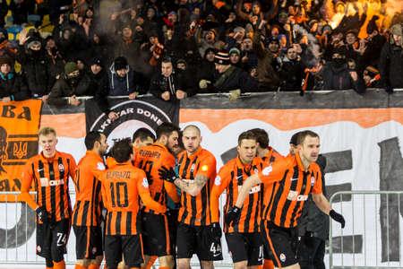 scored: Kiev, Ukraine - December 12, 2016: Players of FC Shakhtar Donetsk celebrate a goal scored during Ukrainian Premier League match against FC Dynamo Kyiv at NSC Olimpiyskiy stadium. Editorial