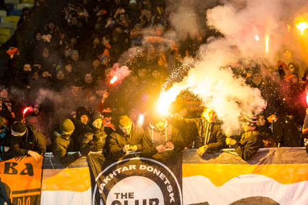 Kiev, Ukraine - December 12, 2016: Ultras of Shakhtar Donetsk in the stands with attributes during the match Ukrainian Premier League game against FC Dynamo Kyiv at NSC Olimpiyskiy Stadium. Editorial