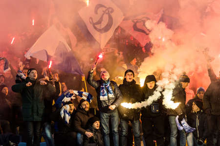 olimpiyskiy: Kiev, Ukraine - December 12, 2016: Ultras of Dynamo Kyiv in the stands with attributes during the match Ukrainian Premier League game against FC Shakhtar Donetsk at NSC Olimpiyskiy Stadium.