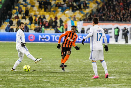 premier: Kiev, Ukraine - December 12, 2016: Junior Moraes of Dynamo Kyiv fighting for the ball with Fred of Shakhtar during Ukrainian Premier League match at NSC Olimpiyskiy stadium. Editorial