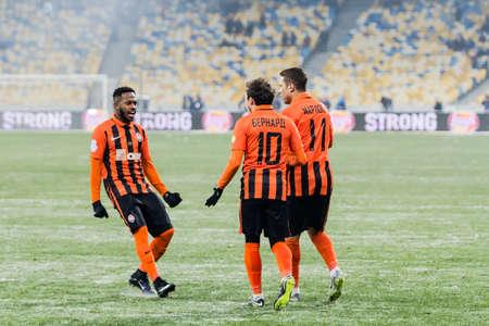 olimpiyskiy: Kiev, Ukraine - December 12, 2016: Players of FC Shakhtar Donetsk celebrate a goal scored during Ukrainian Premier League match against FC Dynamo Kyiv at NSC Olimpiyskiy stadium. Editorial