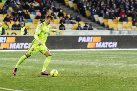 olimpiyskiy: Kiev, Ukraine - December 12, 2016: Artur Rudko of Dynamo Kiev kick the ball during Ukrainian Premier League match against FC Shakhtar Donetsk at NSC Olimpiyskiy stadium.