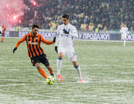 Kiev, Ukraine - December 12, 2016: Yavhen Khacheridi of Dynamo Kyiv fighting for the ball with Facundo Ferreyra of Shakhtar during Ukrainian Premier League match at NSC Olimpiyskiy stadium.