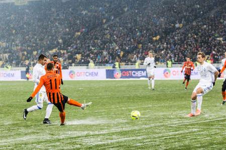 Kiev, Ukraine - December 12, 2016: Marlos of Shakhtar Donetsk shots the ball during Ukrainian Premier League match against FC Dynamo Kyiv at NSC Olimpiyskiy stadium.