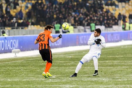 olimpiyskiy: Kiev, Ukraine - December 12, 2016: Derlis Gonzalez of Dynamo Kyiv fighting for the ball with Dario Srna of Shakhtar during Ukrainian Premier League match at NSC Olimpiyskiy stadium. Editorial