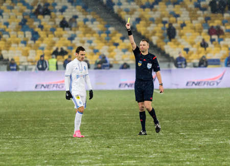 olimpiyskiy: Kiev, Ukraine - December 12, 2016: Serhiy Rybalka of Dynamo Kyiv gets yellow card during Ukrainian Premier League match against FC Shakhtar Donetsk at NSC Olimpiyskiy stadium.