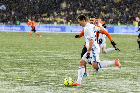 olimpiyskiy: Kiev, Ukraine - December 12, 2016: Yevhen Makarenko of Dynamo Kyiv in action during Ukrainian Premier League match against FC Shakhtar Donetsk at NSC Olimpiyskiy stadium.