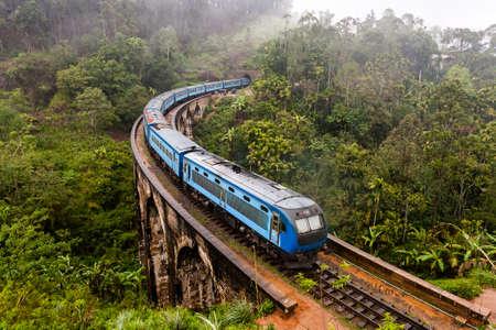 The Nine Arches Bridge Demodara is one of the iconic bridges in Sri Lanka. Morning mist in Ella. Фото со стока