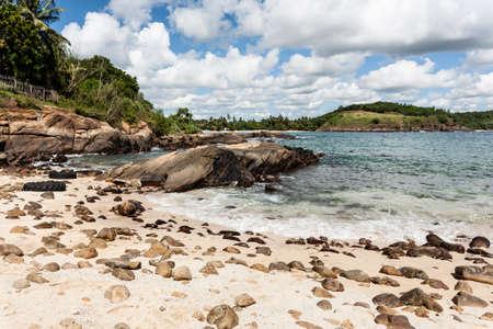 Tropical beach with stones on Sri Lanka. Stock Photo