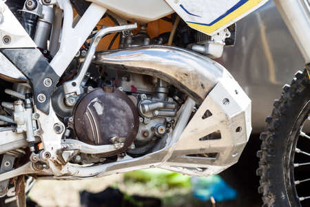 Close-up of muddy engine of dirt motorcycle. Extreme sport competition.