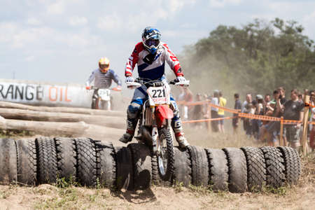 Kiev, Ukraine - July 16, 2017: Motocross riders compete with each other on dirt bikes, during Championship of Ukraine on cross-country final stage. Editorial