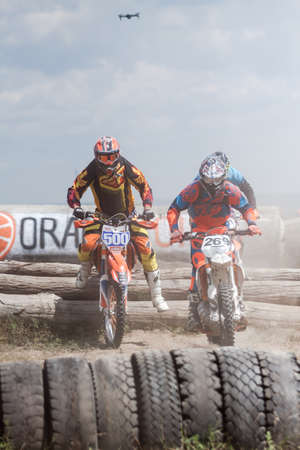 motorcross: Kiev, Ukraine - July 16, 2017: Motocross riders compete with each other on dirt bikes, during Championship of Ukraine on cross-country final stage. Editorial