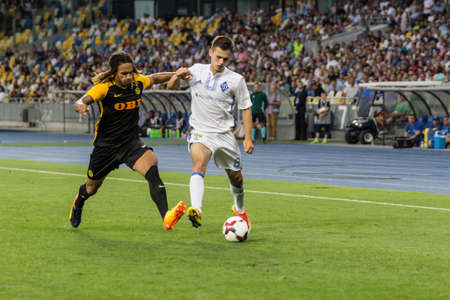 Kyiv, Ukraine - July 26, 2017: Volodymyr Shepeliev of Dynamo Kyiv in action against Kevin Mbabu of FC Young Boys during UEFA Champions League game at NSC Olimpiyskiy stadium.