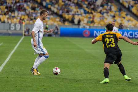 Kyiv, Ukraine - July 26, 2017: Andriy Yarmolenko of Dynamo Kyiv in action against Loris Benito of FC Young Boys during UEFA Champions League game at NSC Olimpiyskiy stadium.