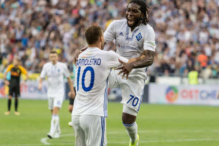 Kyiv, Ukraine - July 26, 2017: Players of FC Dynamo Kyiv celebrate a goal scored during UEFA Champions League game against FC Young Boys at NSC Olimpiyskiy stadium. Editorial