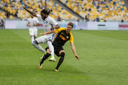 Kyiv, Ukraine - July 26, 2017: Dieumerci Mbokani of Dynamo Kyiv fighting for the ball with Christian Fassnacht of FC Young Boys during UEFA Champions League game at NSC Olimpiyskiy stadium.
