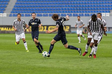 Kyjev, Ukrajina - 27. července 2017: Artem Šabanov v akci během zápasu UEFA Europa League mezi FC Olimpik Doneck a FC PAOK na stadionu Dynamo v Kyjevě na Ukrajině.