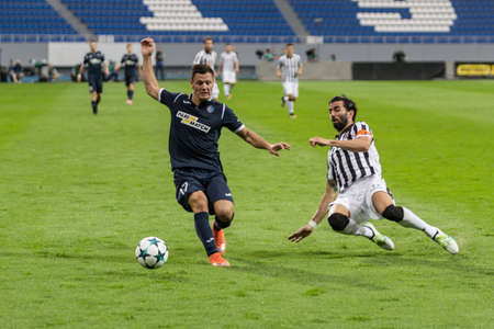Kyiv, Ukraine - July 27, 2017: Serhii Shestakov in action with Jose Crespo during the UEFA Europa League match between FC Olimpik Donetsk vs FC PAOK at Stadion Dynamo in Kyiv, Ukraine. Editorial