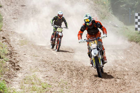 Kiev, Ukraine - July 16, 2017: Motocross riders compete with each other on dirt bikes, during Championship of Ukraine on cross-country final stage. Redakční