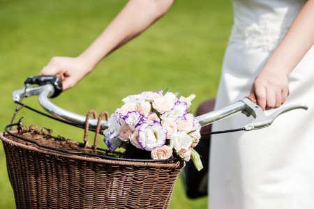 Wedding decoration details, closeup of flower bouquet on retro bike handle bar