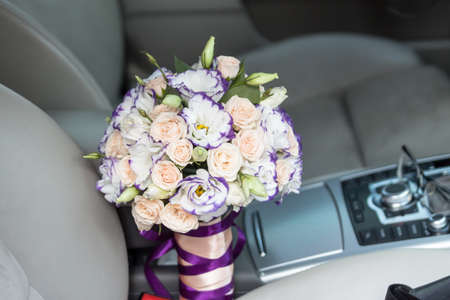Luxury wedding bouquet with pink and white flowers in the car Reklamní fotografie