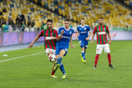 Kyiv, Ukraine - August 24, 2017: Sergiy Sydorchuk in action against Joao Gamboa of Maritimo during UEFA Europa League match at NSC Olimpiyskiy stadium.