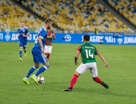 Kyiv, Ukraine - August 24, 2017: Andriy Yarmolenko of Dynamo Kyiv in action against Luis Martins of Maritimo during UEFA Europa League match at NSC Olimpiyskiy stadium.