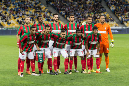 Kyiv, Ukraine - August 24, 2017: Maritimo players before the start game against Dynamo Kyiv during UEFA Europa League match at NSC Olimpiyskiy stadium.