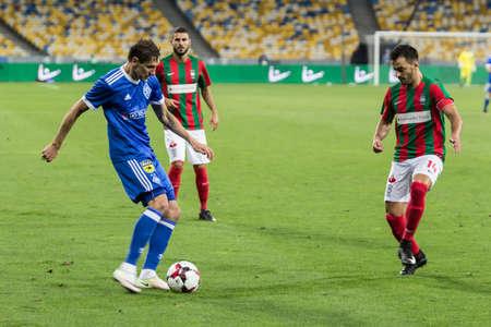 Kyiv, Ukraine - August 24, 2017: Denys Garmash of Dynamo Kyiv in action against Luis Martins of Maritimo during UEFA Europa League match at NSC Olimpiyskiy stadium.