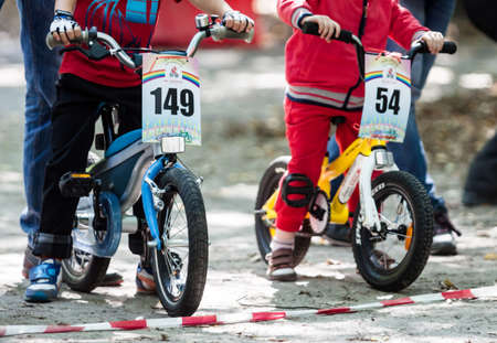 Kiev, Ukraine – September 9, 2017: Unknown young bikers, at the child amateur bicycle competition «We are the champions».