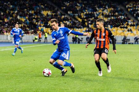 Kyiv, Ukraine - October 22, 2017: Josip Pivaric in action against Marlos. Ukrainian Premier League match Dynamo Kyiv – Shakhtar Donetsk at NSC Olimpiyskiy stadium.