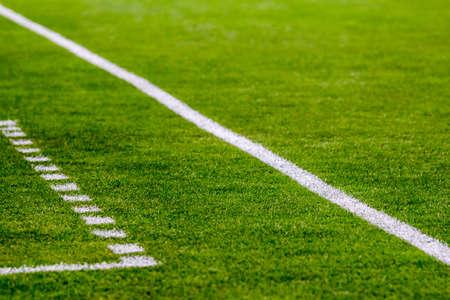 Football field fragment close up white lines Reklamní fotografie