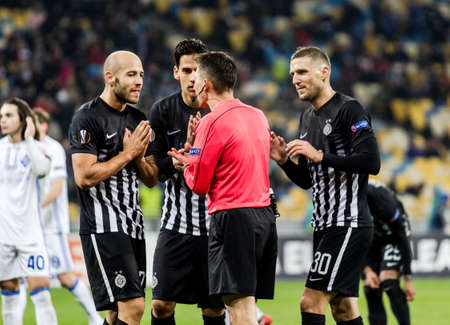 Kyiv, Ukraine - December 7, 2017: Partizan players appeal to the judge in UEFA Europa League match against Dynamo Kyiv at NSC Olympic stadium in Kyiv, Ukraine.