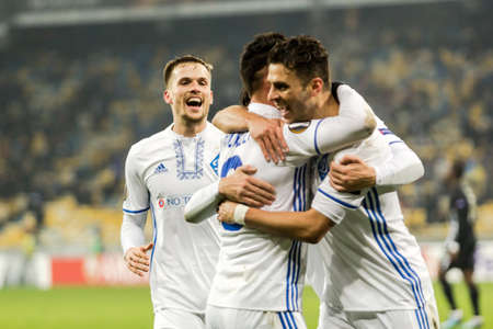 Kyiv, Ukraine – December 7, 2017: FC Dynamo Kyiv players react after score a goal during UEFA Europa League match against Partizan at NSC Olympic stadium in Kyiv, Ukraine.