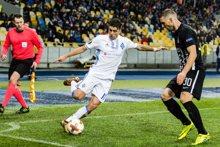 Kyiv, Ukraine – December 7, 2017: Junior Moraes of Dynamo Kyiv fighting for the ball with Milan Mitrovic of Partizan during UEFA Europa League match at NSC Olimpiyskiy stadium. Editorial