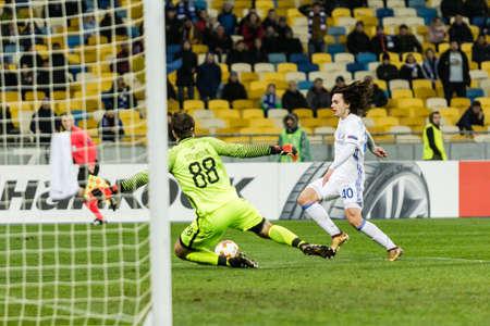 Kyiv, Ukraine – December 7, 2017: Mykola Shaparenko of Dynamo Kyiv fighting for the ball with Vladimir Stojkovic of Partizan during UEFA Europa League match at NSC Olimpiyskiy stadium.