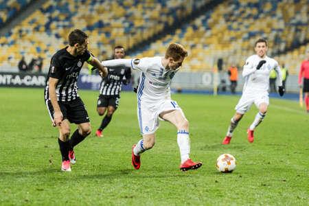 Kyiv, Ukraine – December 7, 2017: Viktor Tsygankov of Dynamo Kyiv fighting for the ball with Miroslav Vulicevic of Partizan during UEFA Europa League match at NSC Olimpiyskiy stadium.